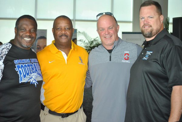 Among the high school coaches attending Lane Kiffin's introduction were (L to R) Spanish River's Bill Ceasar, Boca Raton' eric Davis, Seminole Ridge's Jason Parson and Wellington's Wade Williams.