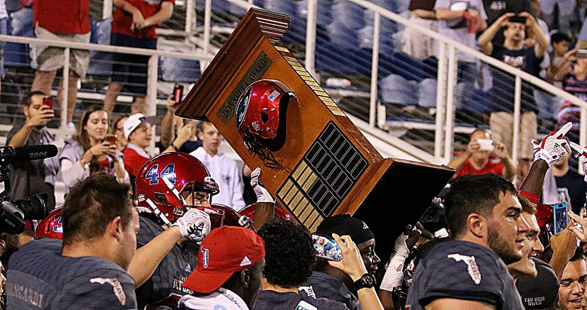 Trophy Dance <div class='secondary-title'><span style='color:#818181;font-size:14px;'>FAU grabbed the Shula Bowl trophy, then raced into the locker room, where a special guest joined the dance. Here's our GameBrowser, filled with Shula Bowl notes.</div>