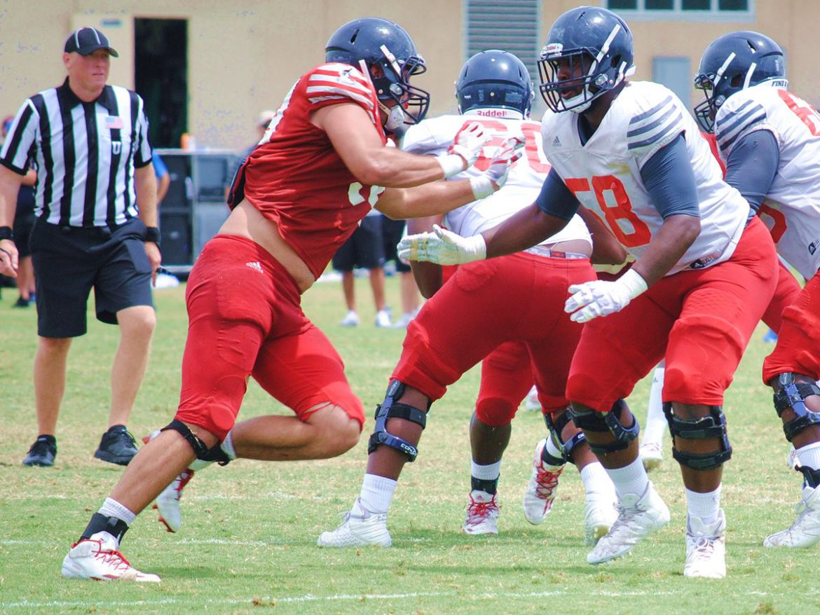 Arms Race <div class='secondary-title'><span style='color:#818181;font-size:14px;'>De'Andre Johnson continues to show improvement, takes step forward in FAU QB battle during Saturday scrimmage.</div>