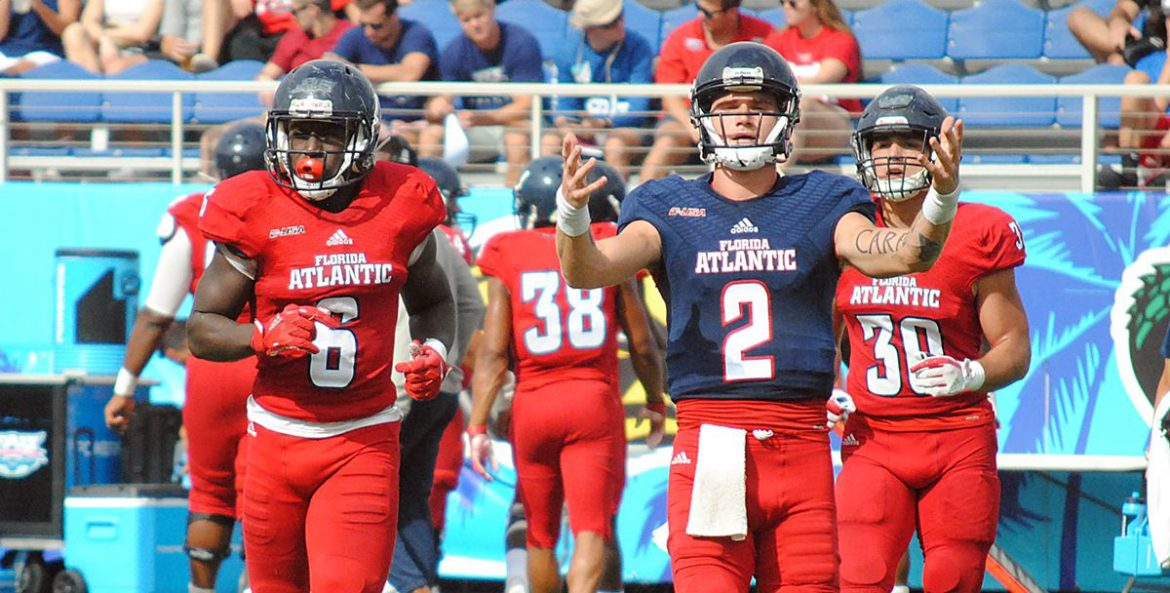 Red Dawn <div class='secondary-title'><span style='color:#818181;font-size:14px;'><b>UPDATED: 10:15 p.m.</b> Quarterback Chris Robison enjoys his best scrimmage, leads Red team to a 20-14 victory over White in the FAU spring game.</div>