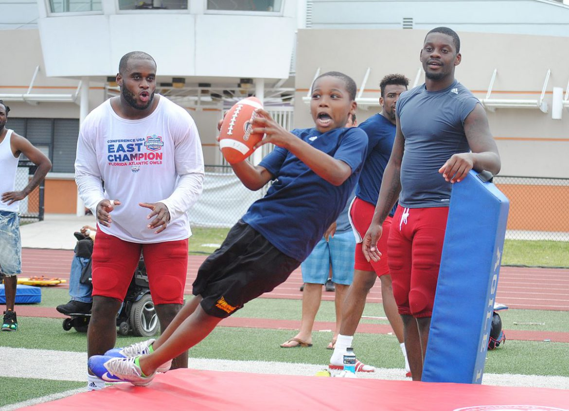 Youth Served <div class='secondary-title'><span style='color:#818181;font-size:14px;'>All smiles on the field during FAU youth football camp following Saturday's spring scrimmage at Carter Park. </div>
